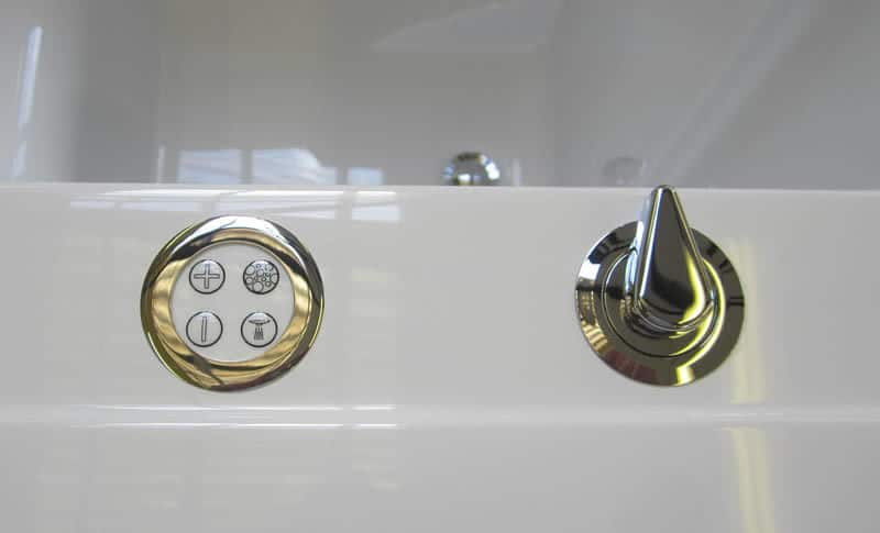 Electronic hydrotherapy copntrols on the rim of a Cabuchon bath