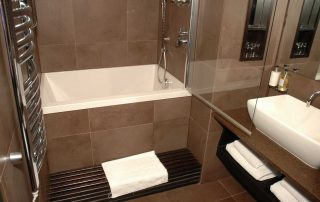 Calyx deep soaking tub in a hotel bathroom