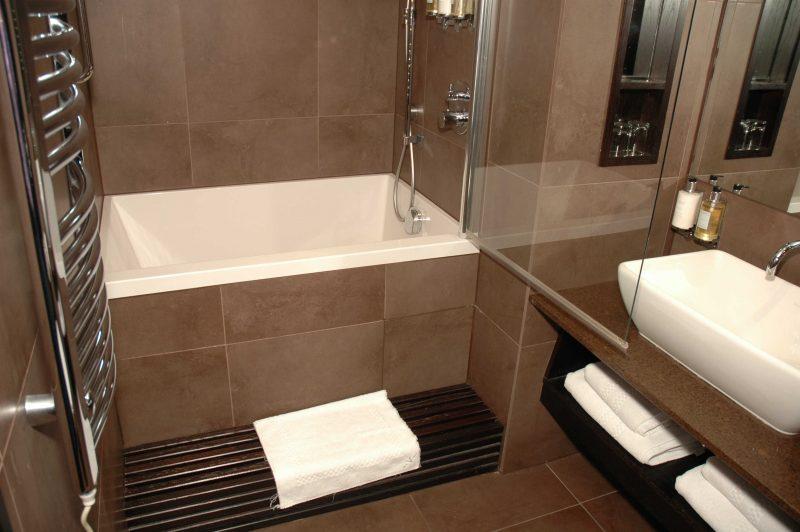 Calyx deep soaking tub in a hotel bathroom