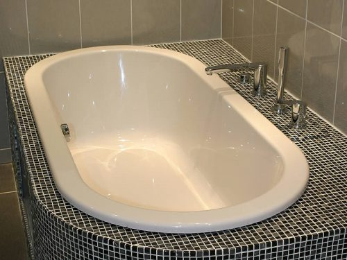 The Arcadia double-ended bath, inset into a tiled surround
