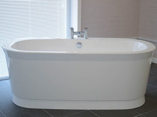 The Artesia free standing bath, pictured on its dedicated plinth