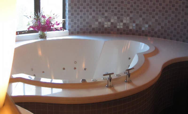 A bespoke luxury bath, also incorporating a custom hydrotherapy system.