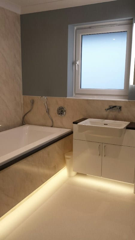 The bath and accompanying units feature attractive under-lighting