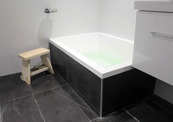 The Calyx 1230 Japanese Soaking Tub with coloured side panels