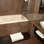 The Calyx minimalist-style soaking tub with tiled surround in a boutique hotel
