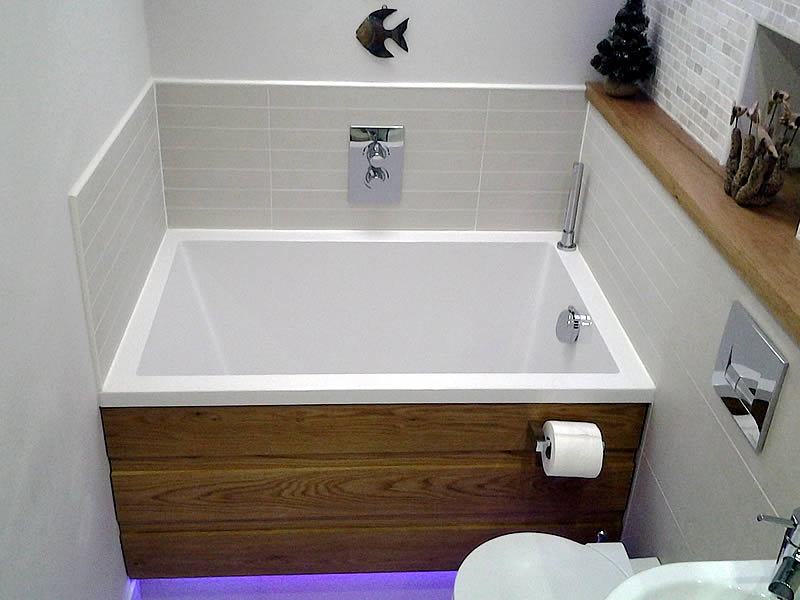 The Calyx soaking tub set in a narrow bathroom