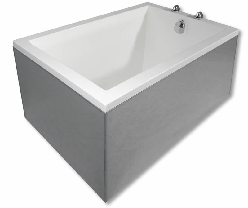 A Calyx deep soaking tub with a front/left panel of a different colour to the bath.