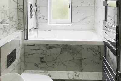 The Nirvana deep soaking tub, installed across a narrow bathroom