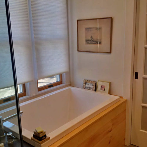 Soaking tub, New York. The Calyx in the newly restored bathroom in Brookhaven.