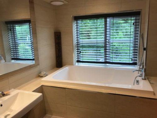 The Nirvana deep soaking tub - installed in a narrow bathroom alcove