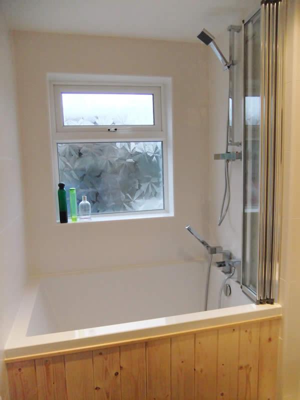 The deep soaking tub set against a window, Northern Ireland
