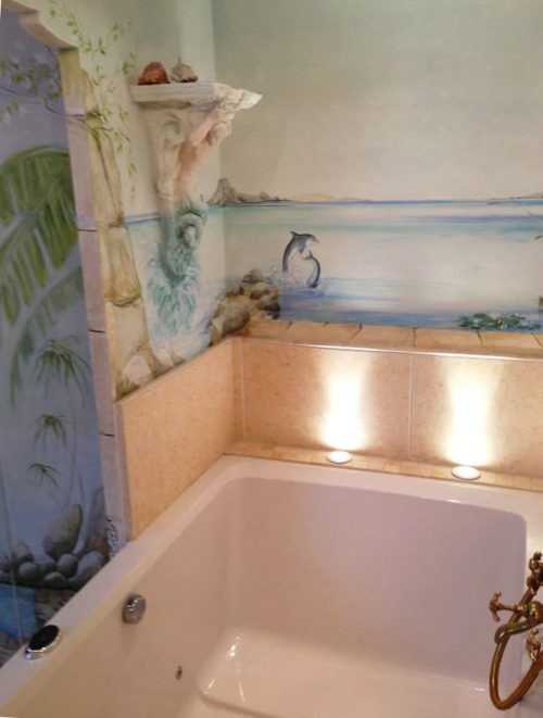 The Xanadu two-seat soaking tub, inset beneath a mural