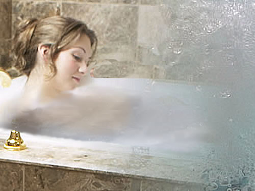 a woman relaxing in a hydrotherapy bath