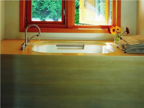 The Imersa deep soaking bath in a window setting