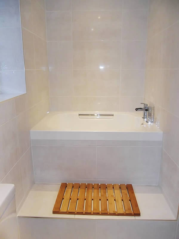 The Imersa soaking tub in its finished position, shown inset in a tiled surround.