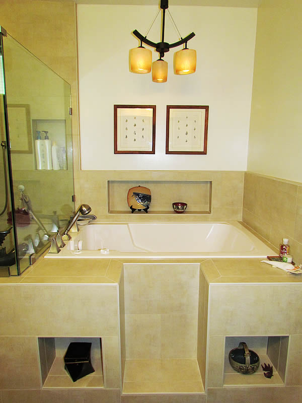 The Nirvana soaking tub in a custom tiled surround