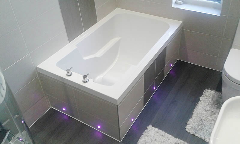 The Nirvana deep soaking tub features an integrated seat and armrests