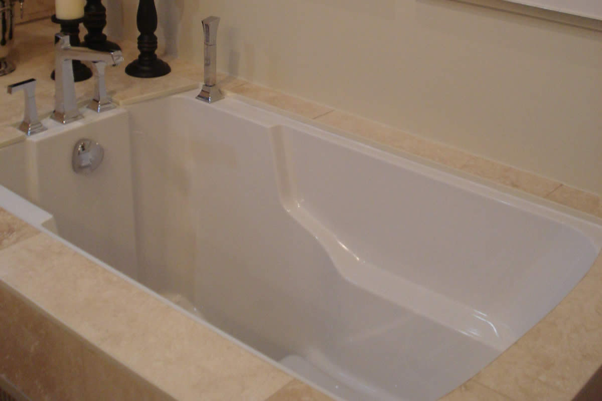Japanes style soaking tub, Ontario Canada. Shown with a marble surround.
