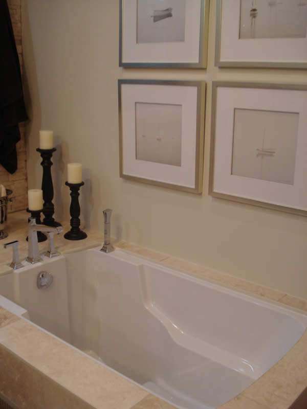 The Nirvana Japanese style soaking tub in its marble surround. Ontario.