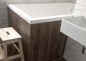 The Calyx 1440 Japanese soaking tub installed with wooden side panels, UK