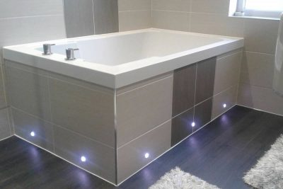 The soaking tub inset in a tiled surround with LED underlighting. Dundee, Scotland.