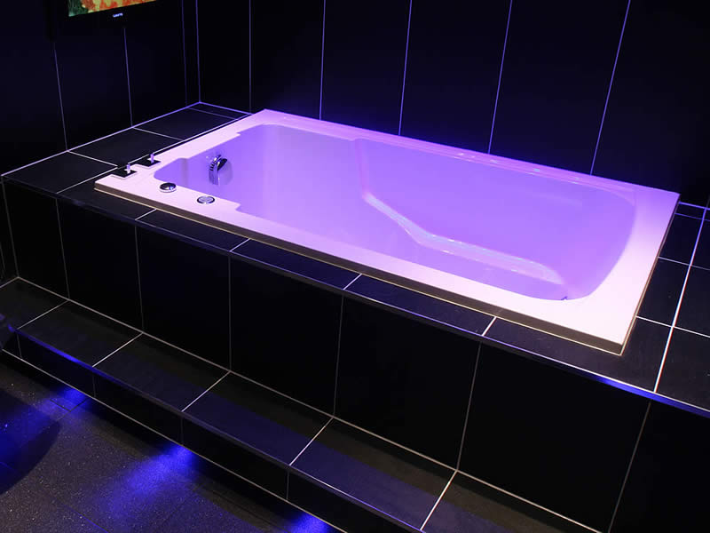 Here, the Nirvana soaking tub is shown semi-sunken into the floor.