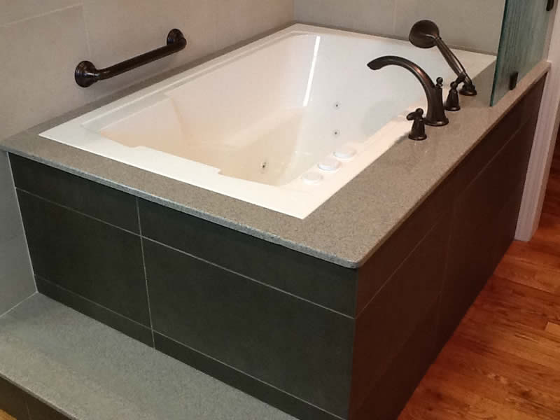 The Nirvana deep soaking tub, shown undermounted and with an external step