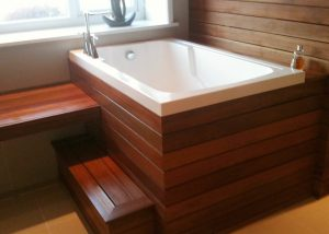 The Nirvana Japanese deep soaking tub in a wooden surround, England, UK