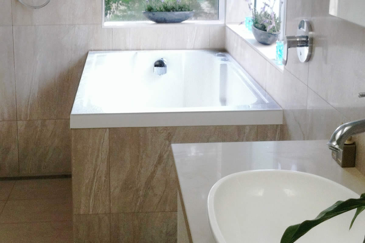 The Nirvana, a Japanese style soaking tub, here used as a corner bath in Australia