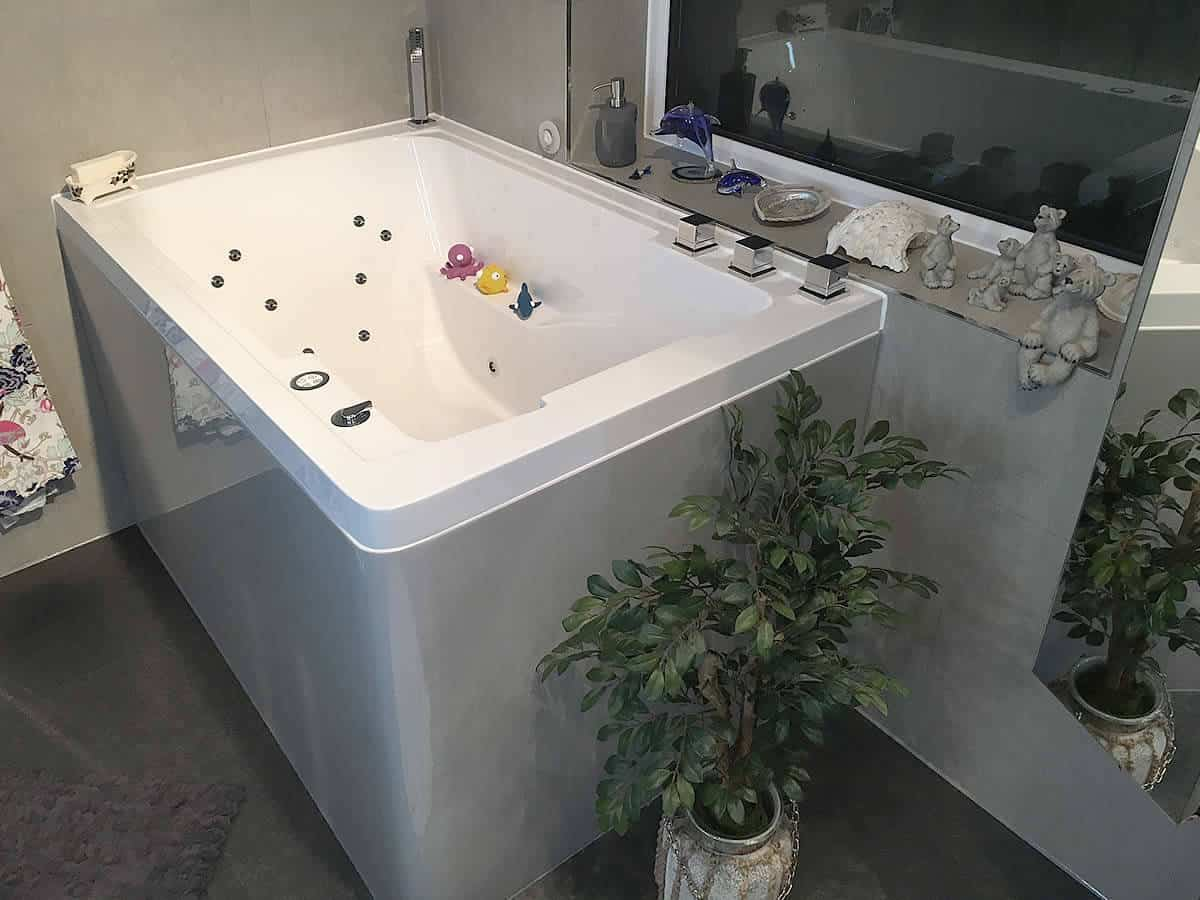 An interior view of the specially adapted Nirvana soaking tub, complete with bespoke hydrotherapy system, coloured side panel and specially curved corner.