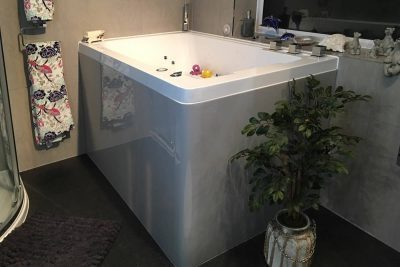 The modified deep soaking tub, with its specially shaped and coloured bath panel