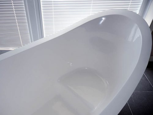 A view of the inside of the bath, showing its in-built seat