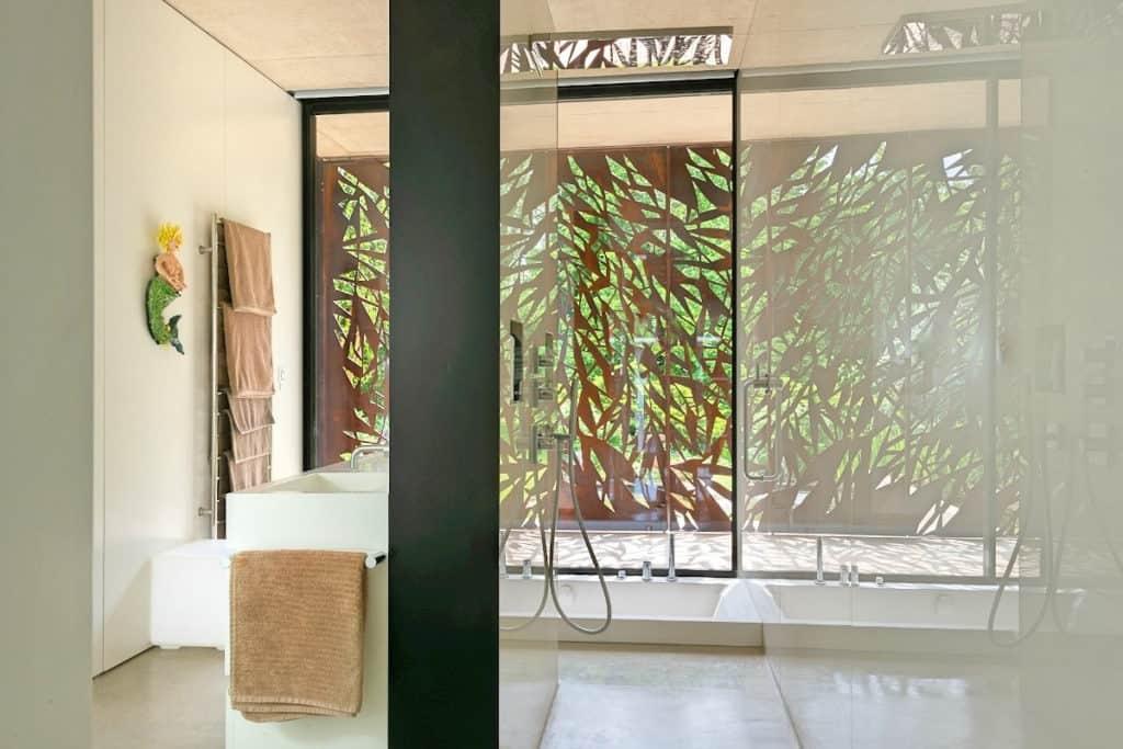 The sunken bath, set by a window in the wet-room
