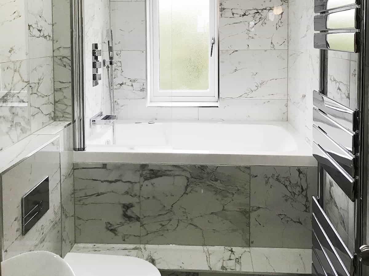 The Nirvana deep soaking tub, installed across a narrow bathroom