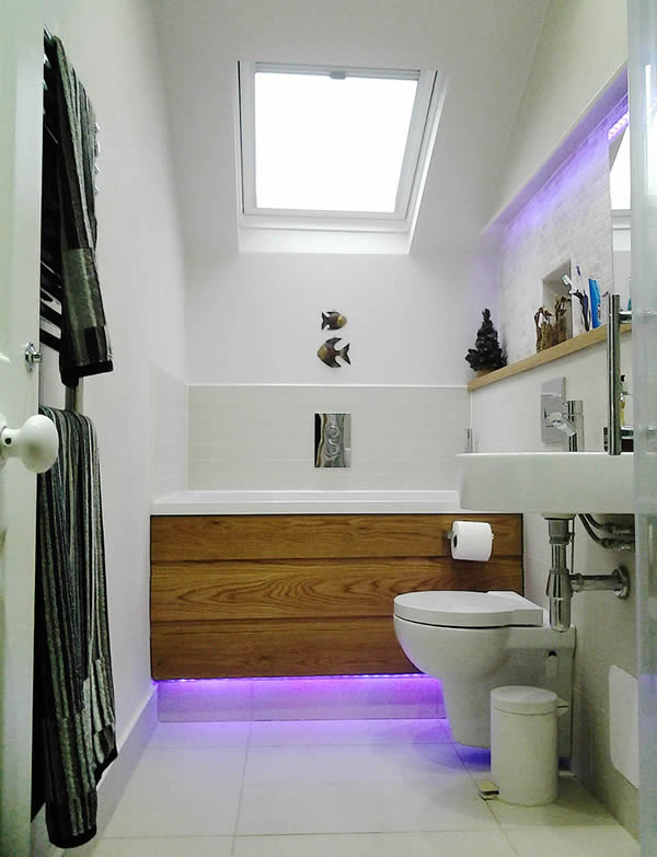 the calyx in a small bathroom with wooden panel and