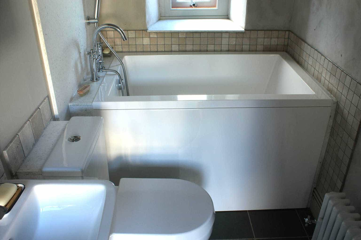 Space saving bath scotland for Narrow deep soaking tub