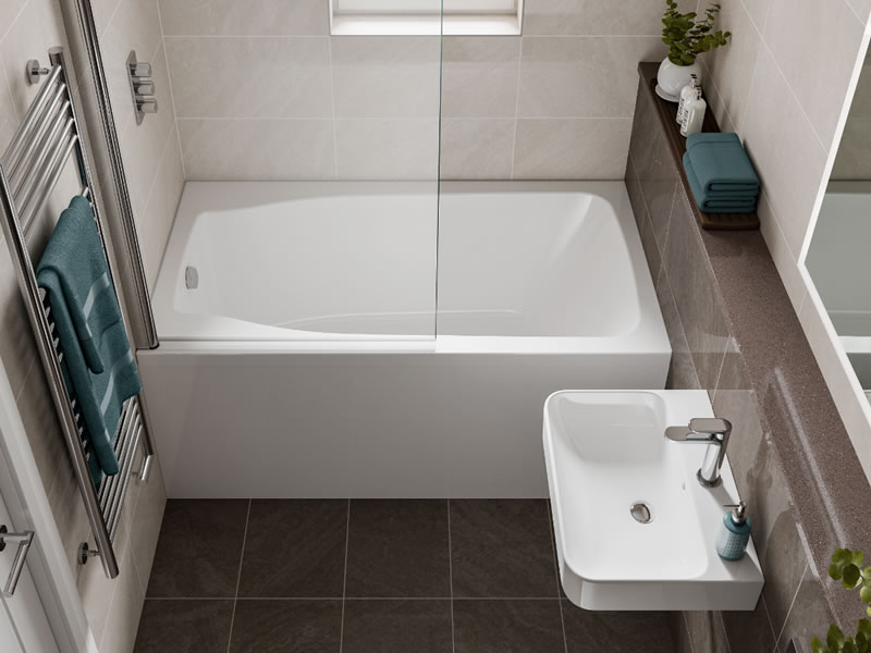 The Studio compact bath, seen closer up, with shower screen
