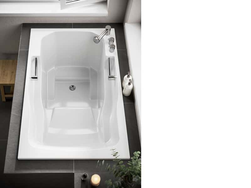 Internal view of the Takara soaking tub, showing the grab rails, seat, armrests and footrests