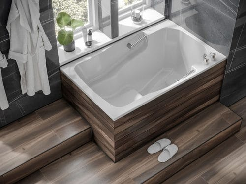 View of the easy-access Takara deep soaking tub, showing the interior seat, grab rails and armrests.