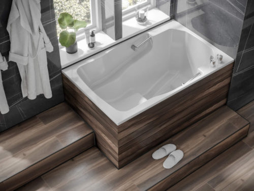 The Takara easy-access deep soaking tub, with wooden surround and step.