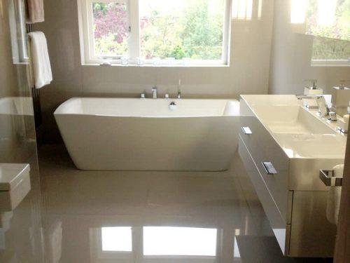 Talisien double ended bath beneath a window