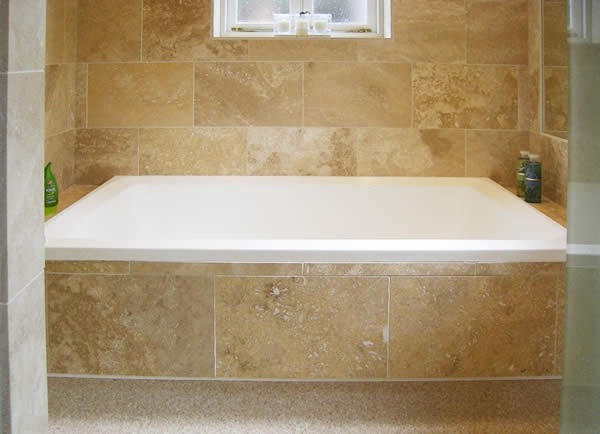 The Xanadu two-seater deep soaking tub, here shown inset into a tiled surround.