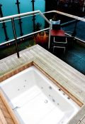 The Xanadu Japanese-style soaking tub, shown outdoor on a penthouse terrace