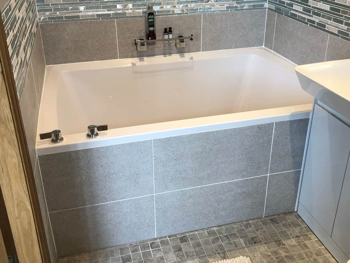 The Xanadu 2-person soaking tub, installed in a bathroom alcove
