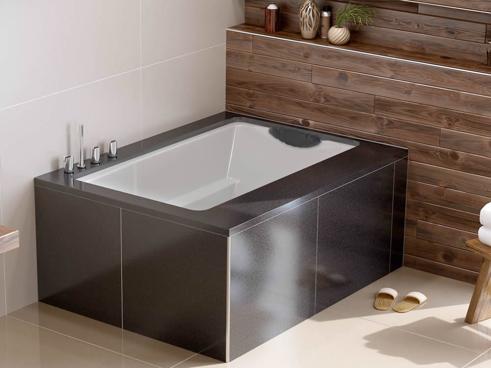The Yasahiro deep soaking tub, used as a coner bath, undermountedbeneath a tiled surround
