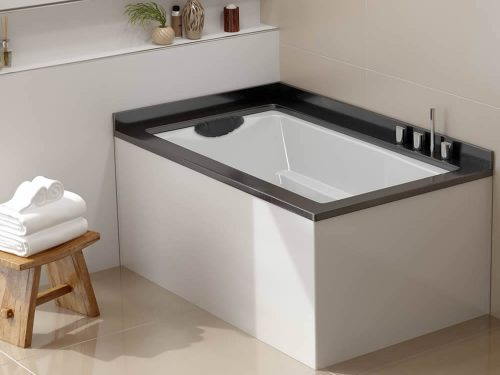 The Yasahiro Japanese style soaking tub, used as a corner bath. Shown undermounted witha Ficore panel.